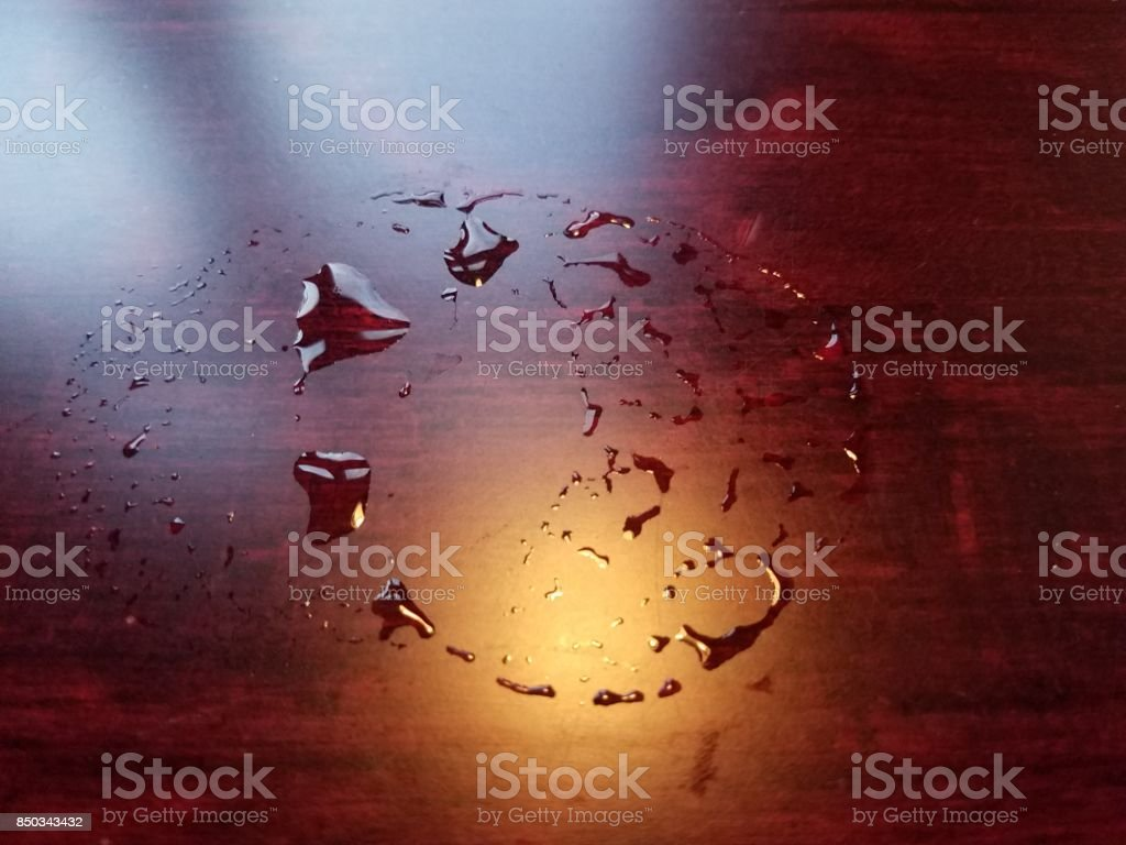 water from glass on wood table stock photo