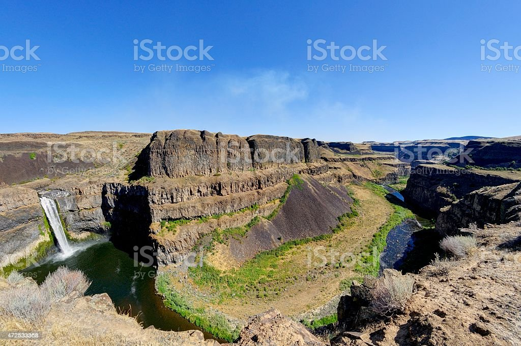 water from Palouse Falls flows to a canyon stock photo