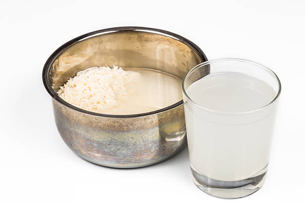 Water from rice rinse can be used as natural fertilizer stock photo