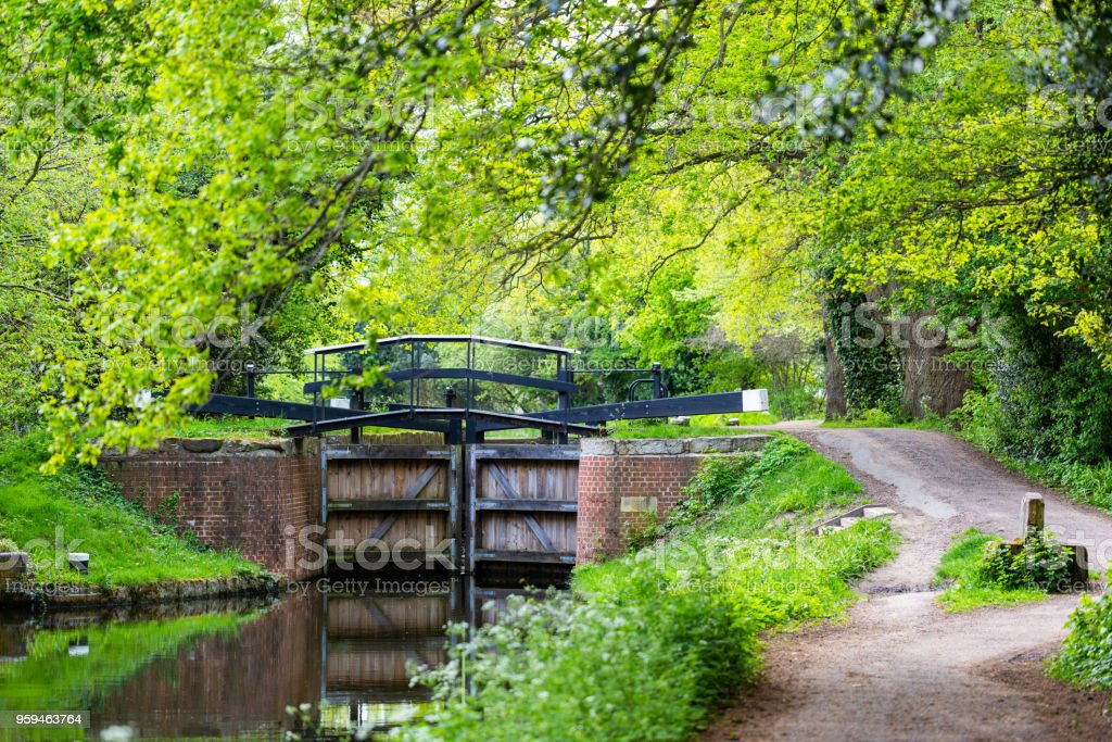 Water gates on Bansigstoke Canal at walkpath in Goldsworth Park near St John village in Woking stock photo