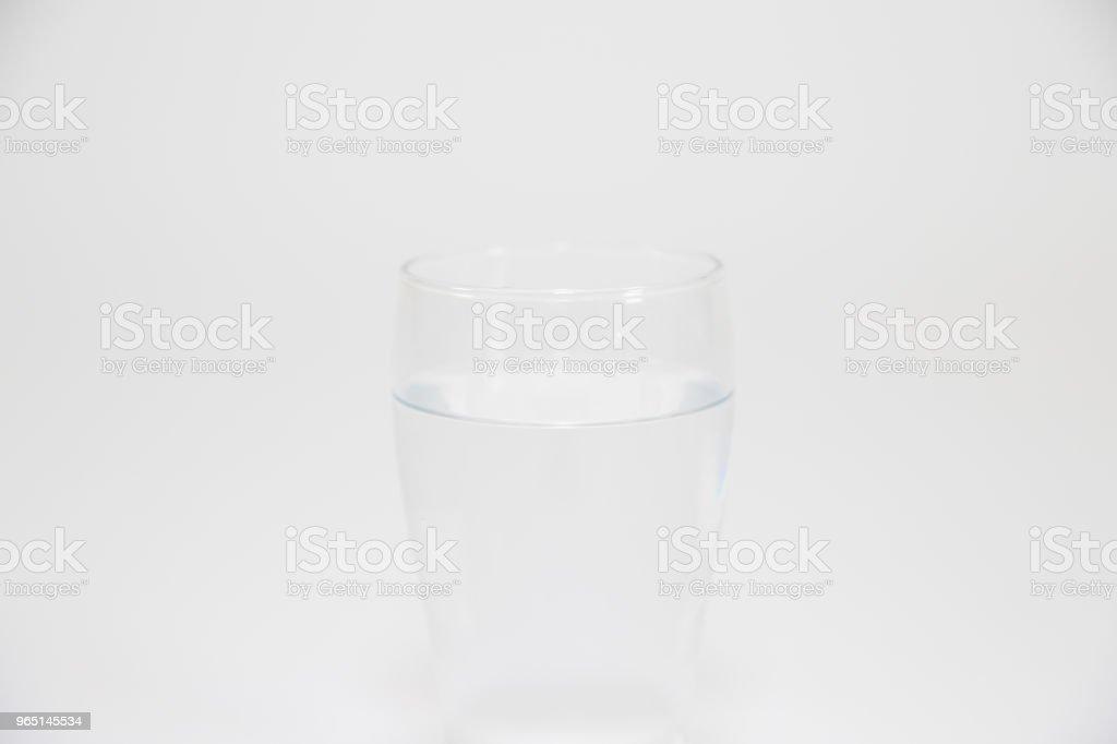 Water glass isolated on white zbiór zdjęć royalty-free
