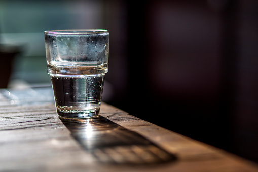 water glass on wooden table
