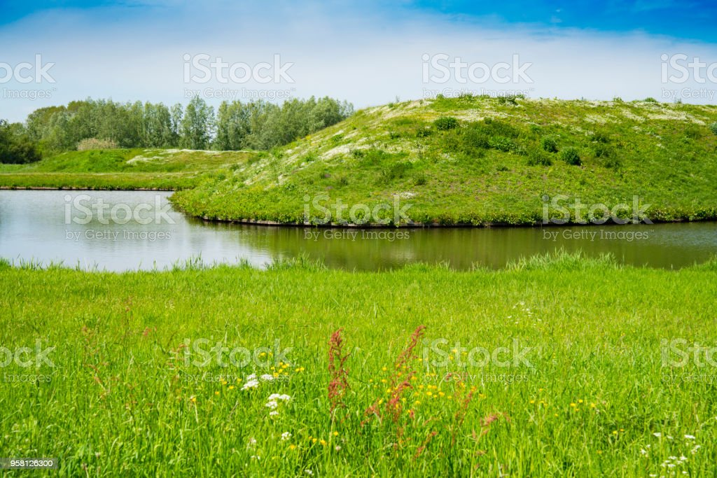 water, green hill in park  Terheijden, The Netherlands stock photo