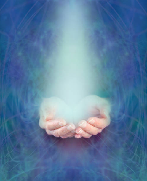 Water Healer female hands emerging from ethereal watery dark turquoise background with gentle beam of light pooling in cupped hands cryotherapy stock pictures, royalty-free photos & images