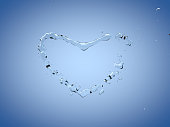 Splashes and drops of water in the shape of a heart on a blue background. Abstract 3d illustration
