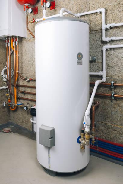 water heater in modern boiler room stock photo