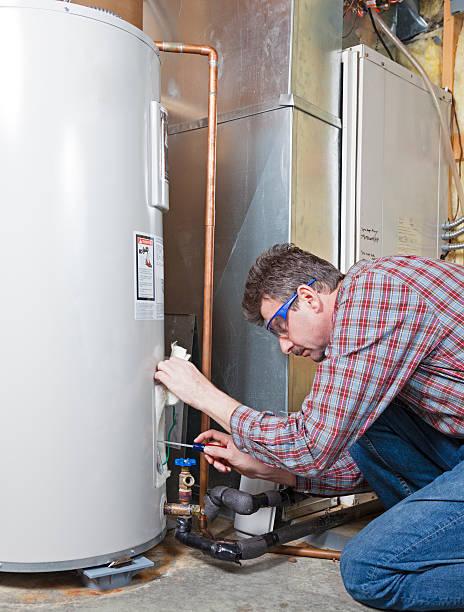 Water heater maintenance stock photo