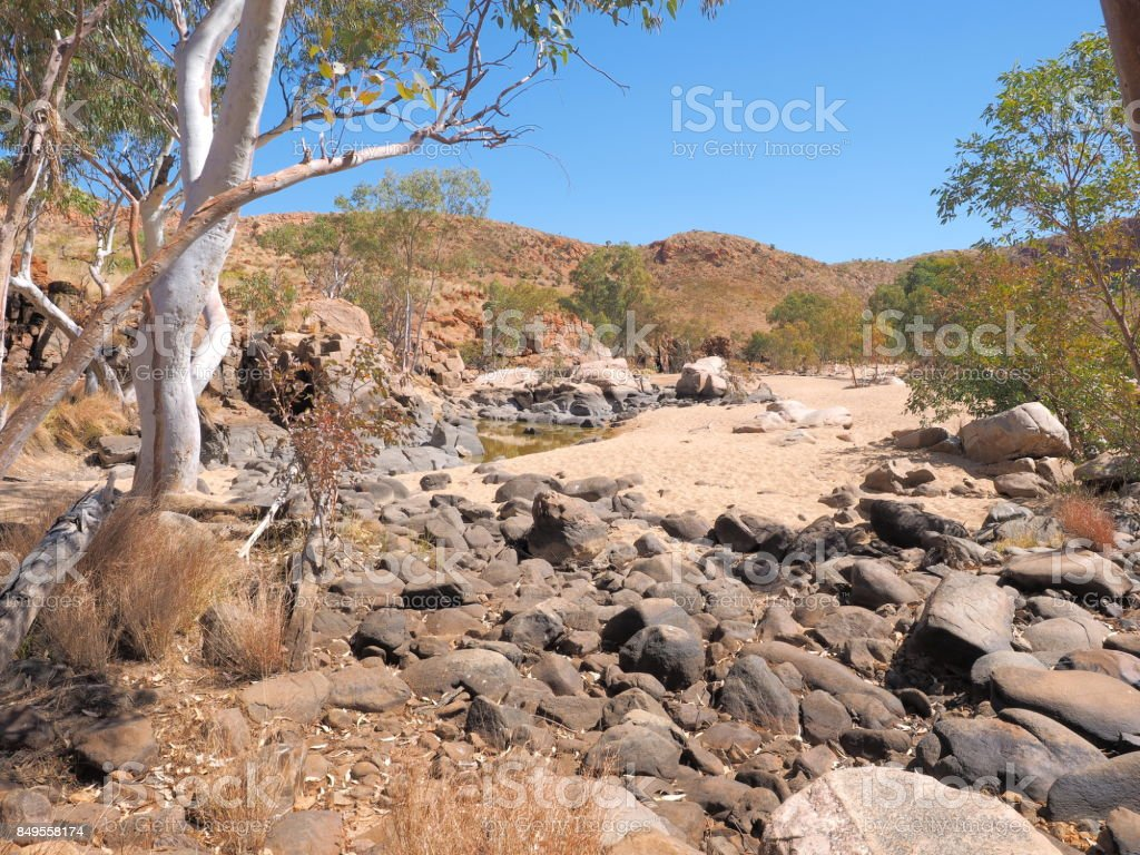 Water hole along the rim walk in the dry Ormiston Pound stock photo