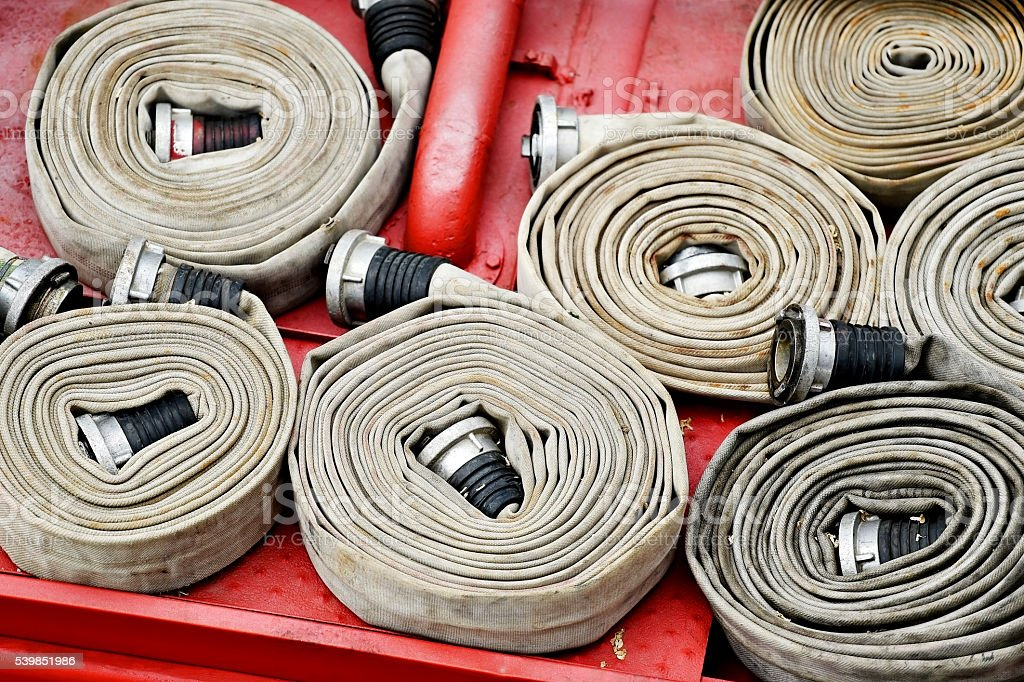 Water hoses on top of a firefighter vehicle stock photo