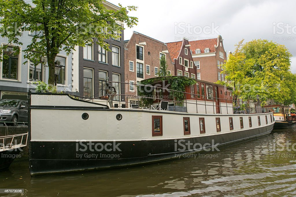 water house boats are located at channels in amsterdam holland