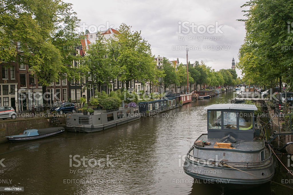 water house boats are located at channels in amsterdam holland...