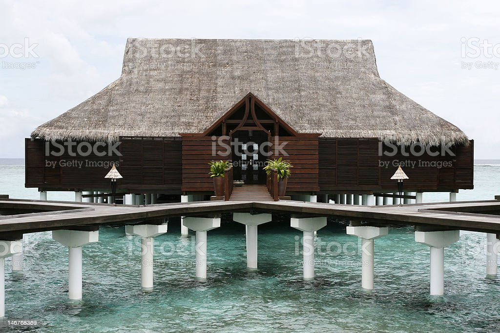 Water House With Grass Roof royalty-free stock photo