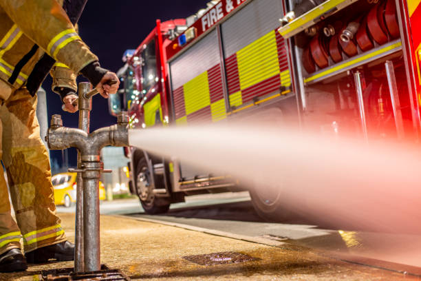 Water Hydrant Fire Service Checking a Water Hydrant fire hydrant stock pictures, royalty-free photos & images
