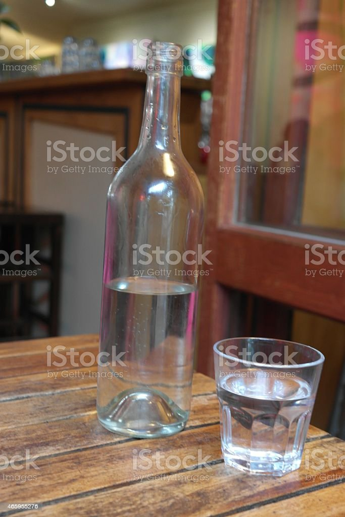 Water in bottle and glass stock photo