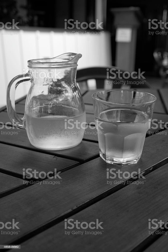Water in carafe an glass stock photo