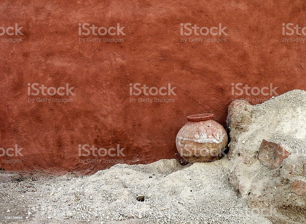 Water Jar and adobe wall in desert village , Rajasthan, India stock photo