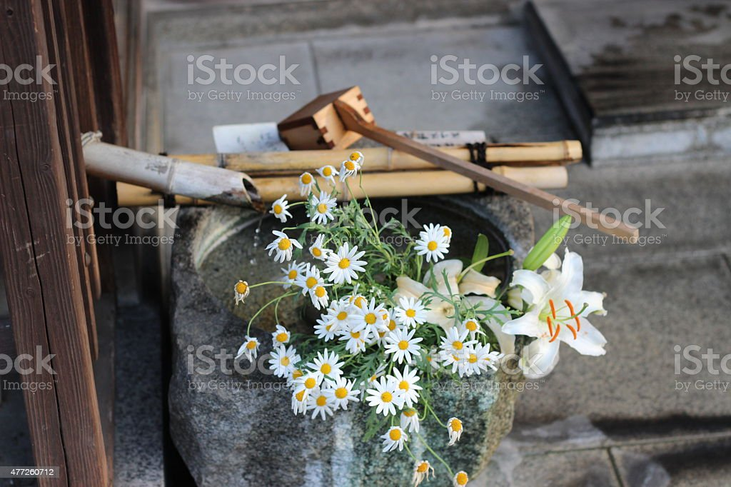 Water jar and flowers stock photo