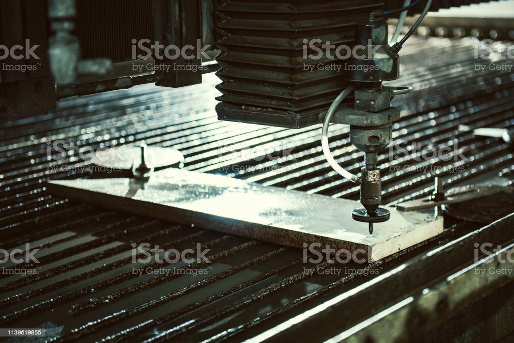 Water Jet Cutter Machine Cutting Steel Plate Stock Photo - Download
