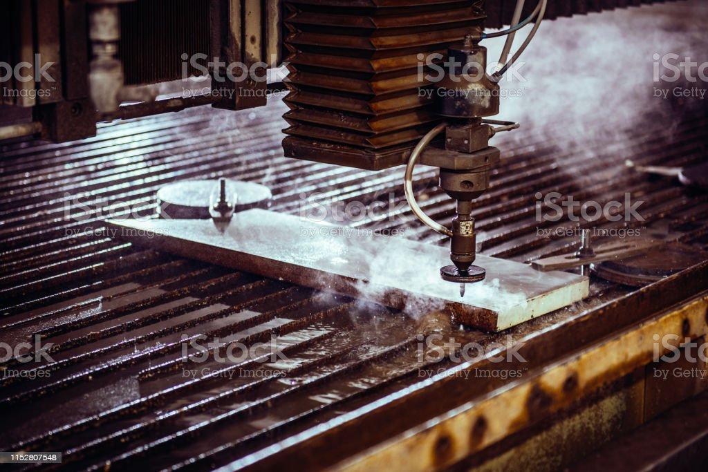 Water Jet Cutter Machine Cutting Steel Plate Stock Photo