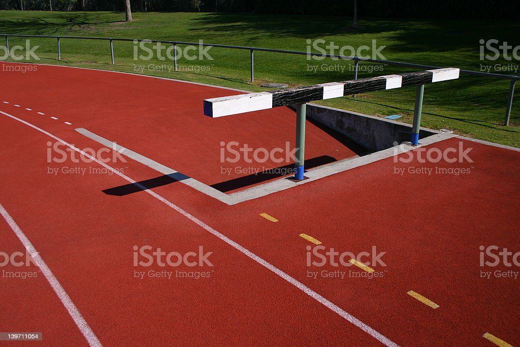 Water Jump on an athletic track royalty-free stock photo
