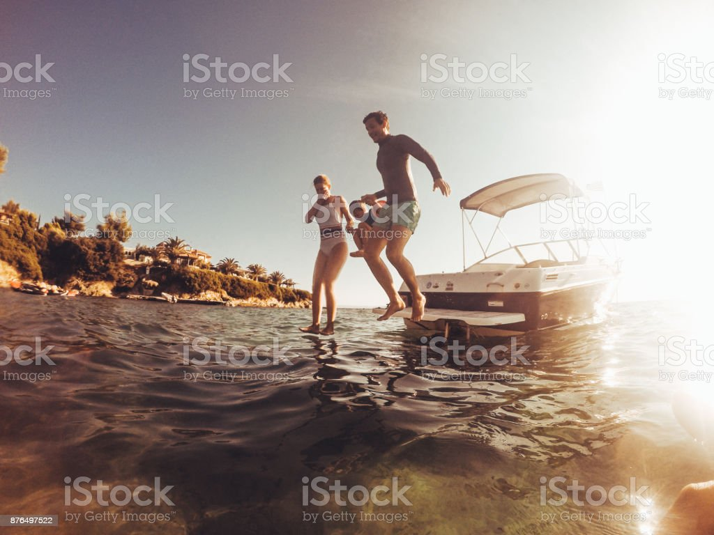 Water jumping with my family stock photo