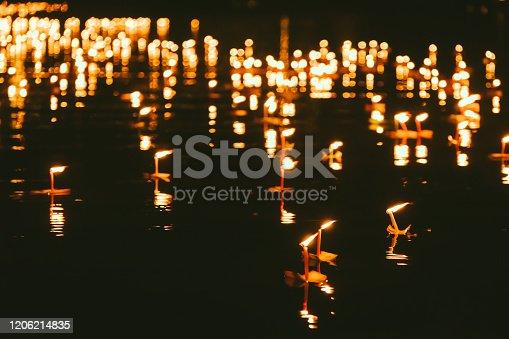 Water lantern in river at night in Loy Krathong Festival in Thailand