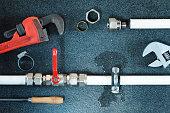 Water leak on a water pipe. Repair plumbing background.