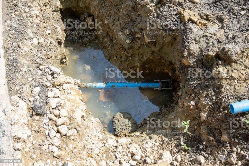 Water leak A burst waterpipe has been dug up Broken Stock Photo