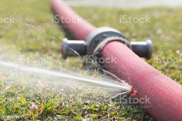 Water Leaking From Hole In A Hose Stock Photo - Download Image Now