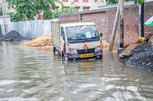 17th june 2021 kolkata west bengal india :Pictures of the streets of Kolkata submerged in the rain. Almost the whole of Kolkata is submerged in today's heavy rains. People are being forced to carry out their daily activities through this rain water.
