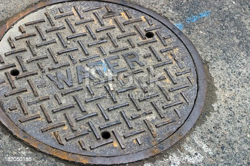 Water manhole cover in the street