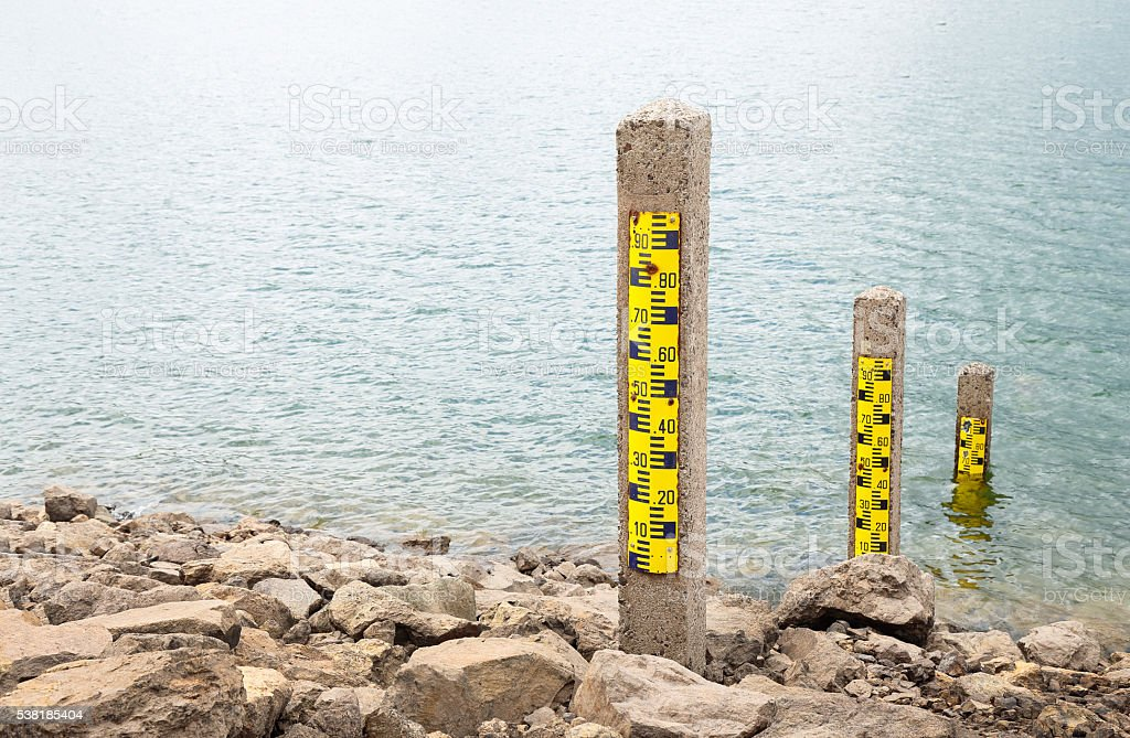water measuring pole water level meter showing low levels after a period of drought Dam Stock Photo