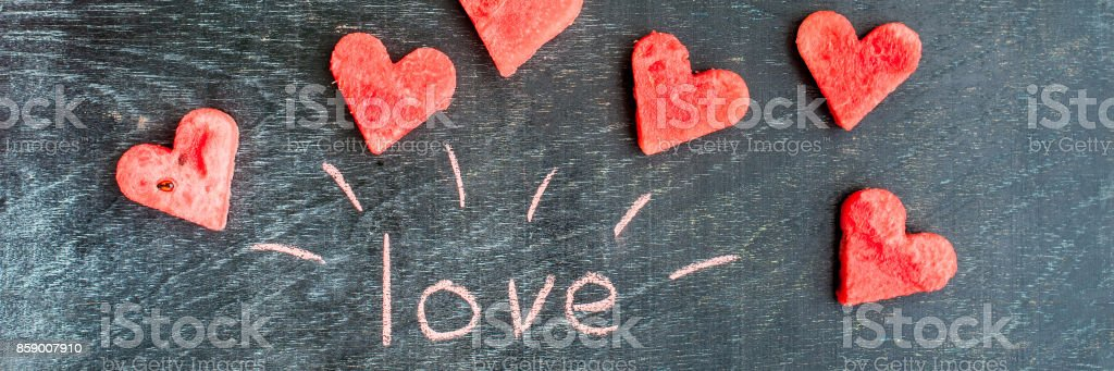 banner water melon cut into heart shape inscription love with chalk