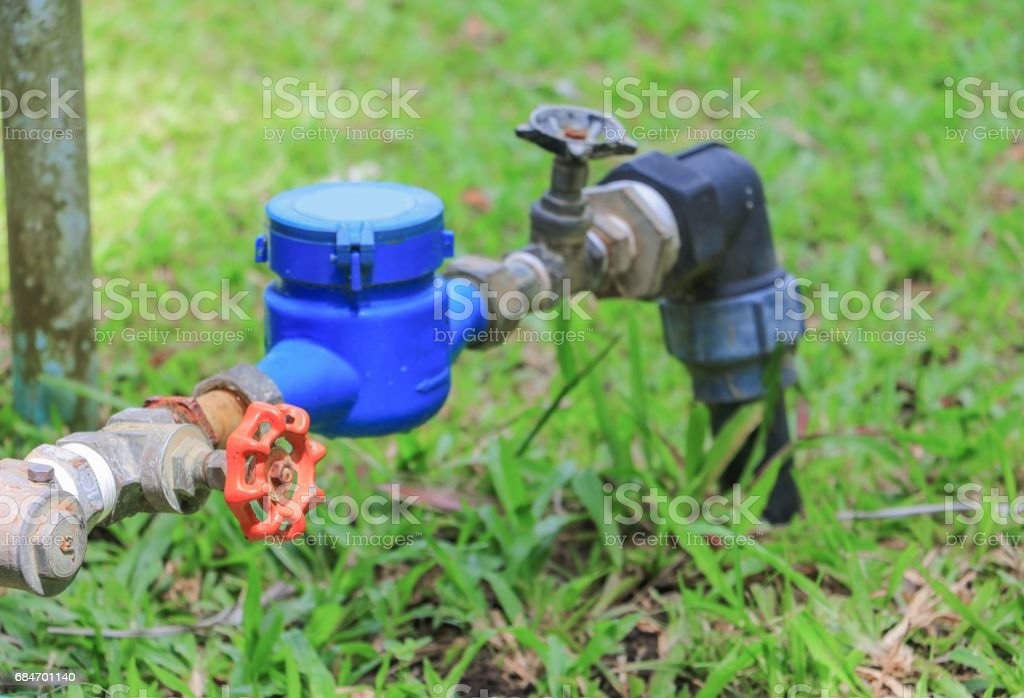 Water meter valve.  tap pipe  on floor grass, with copy space for add text stock photo