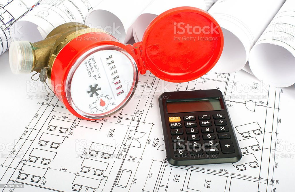 Water meter with calculator on blueprint stock photo