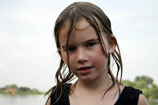 water nymph in the evening on the lake after the bath wet hair stock pictures, royalty-free photos & images