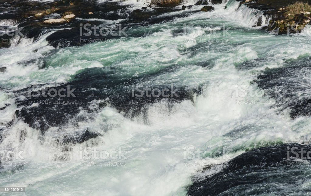 Water of the Rhine river just above the Rhine Falls royalty-free stock photo