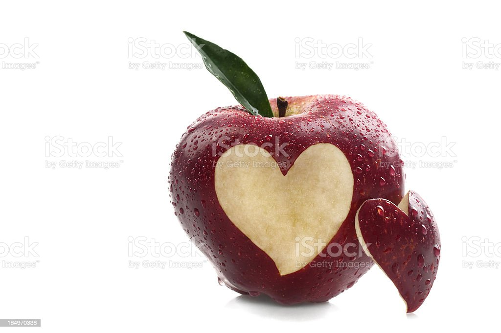 Water on Red Apple With Heart Shape stock photo
