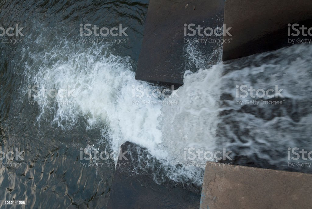 Water over concrete dam for Sugar cane cultivation.