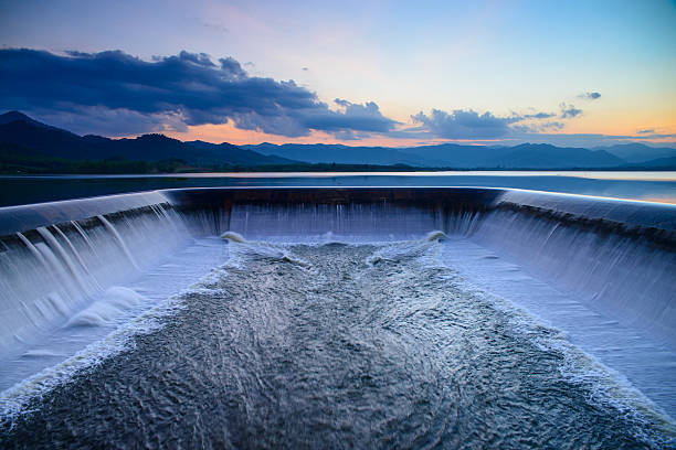 water overflow into a spillway - hydroelectric power stock photos and pictures