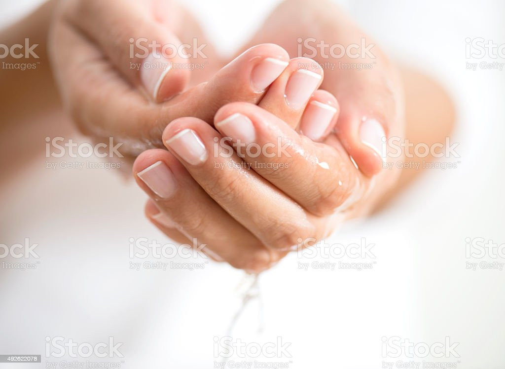 Water Caucasian female is holding water in hands, horizontal 2015 Stock Photo