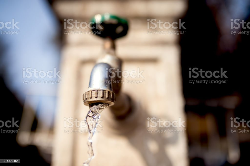 Water pipe flowing water. stock photo