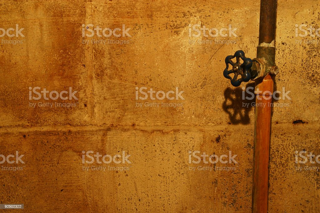 Water Pipe Valve and Block Wall royalty-free stock photo