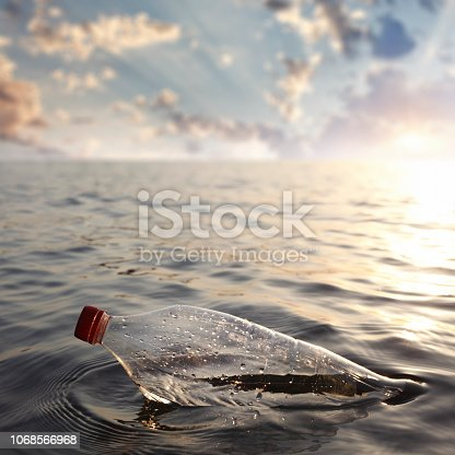 Plastic bottle in the ocean with copy space.