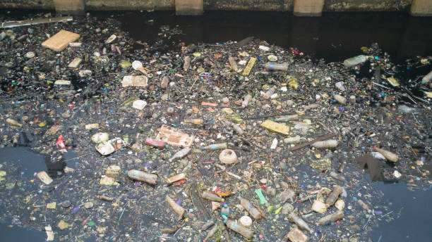 Water pollution effects Dirty garbage in canal. The Water pollution effects Dirty garbage in canal. environmental damage stock pictures, royalty-free photos & images