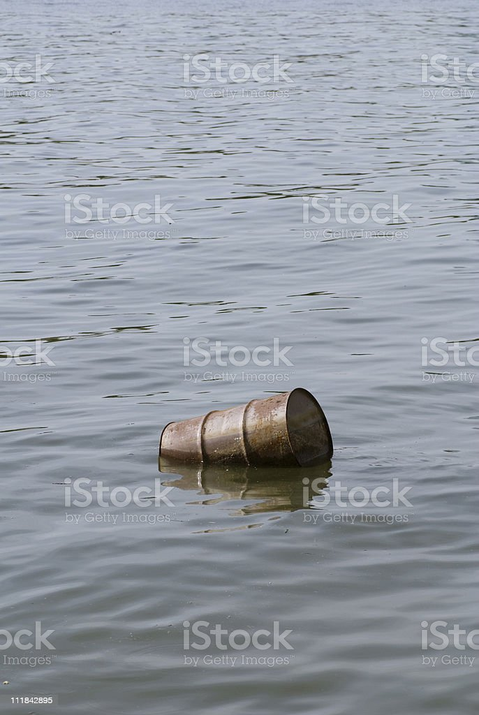 Water pollution - floating oil barrel royalty-free stock photo