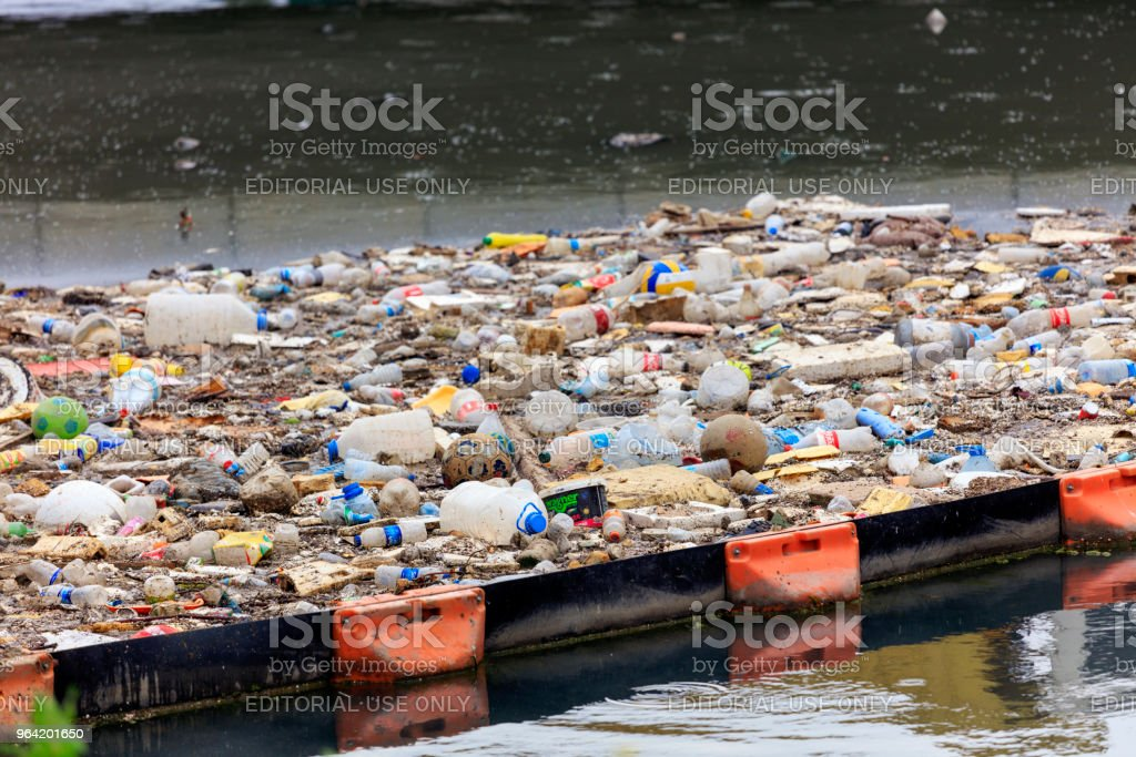 Water Pollution - Polluting the Seas. Plastic waste floating in a...