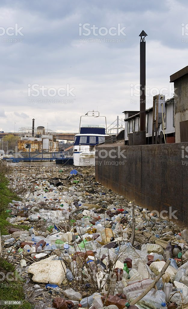 Water pollution - river full of plastic bottles royalty-free stock photo