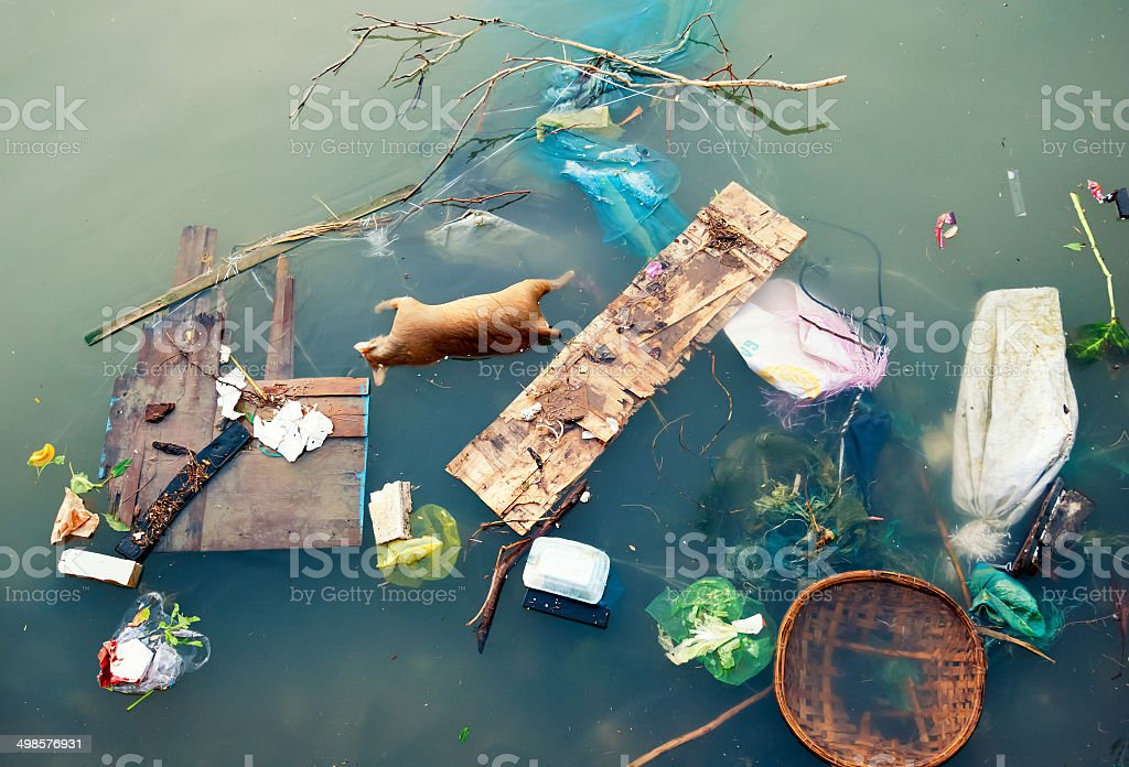 Water pollution with plastic garbage and dirty trash waste stock photo