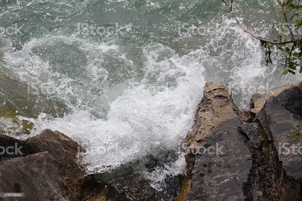 Water Pooling at the Rocky Shoreline of Lake Michigan stock photo